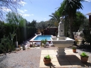 A charming country villa with pool and large tranquil gardens in Busot, Alicante